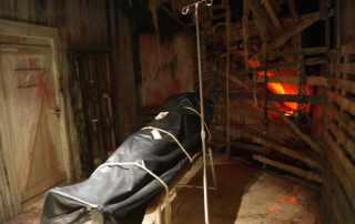 scenografia sala torture per escape room